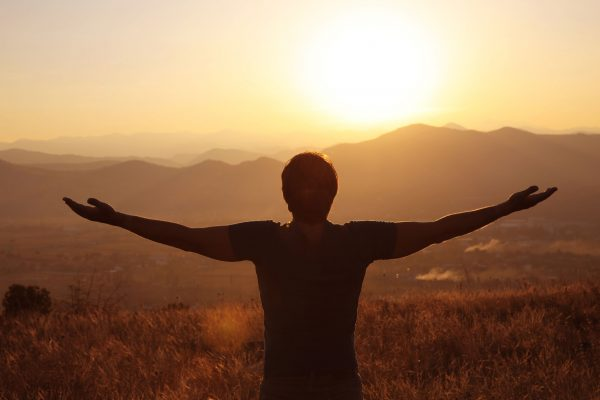 Freedom. Free man with open arms on sunset. success. Travel. Good life.